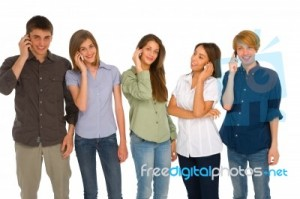 teenagers-talking-over-phone-100103347
